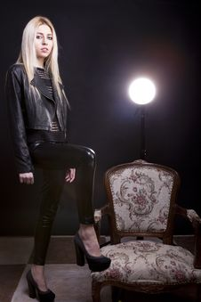 Free Sensual Blonde With A Leg On A Vintage Chair And A Studio Light Stock Photo - 30446310