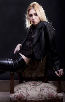 Free Sensual Blonde Model On A Vintage Chair Stock Photo - 30446350