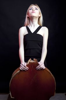 Free Elegant Girl Behind A Broken Contrabass On Black Background Stock Images - 30446384