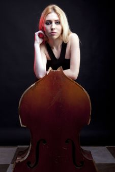 Free Elegant Girl Behind A Broken Contrabass On Black Background Royalty Free Stock Images - 30446389