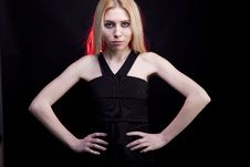 Free Gorgeous Blonde Model With A Red Light Behind Her Stock Photography - 30446412