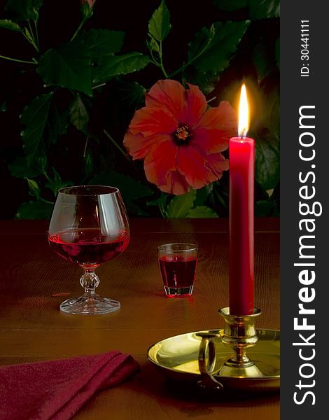 A glass of red wine, a small glass with liquor