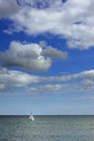 Free Sail Boat Out In The Ocean Royalty Free Stock Image - 30450296