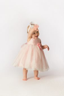 Free Little Girl In Frilly Dress Waving Royalty Free Stock Photography - 30453627