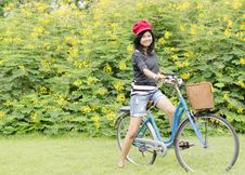 Free Young Woman On A Green Meadow With A Bicycle Royalty Free Stock Photos - 30460098