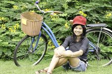 Free Girl With A Bicycle Rests On A Grass Stock Photography - 30460162
