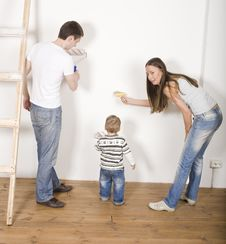 Parents With Their Son Near Ladder