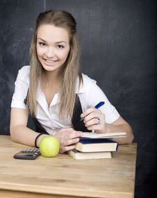 Free Cute Young Student Near Blackboard With Copy Book Calculator Pen, Copy Space Stock Photo - 30465840