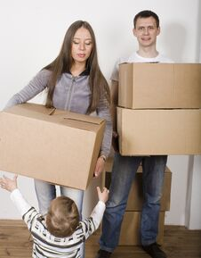 Free Smiling Family In New House Playing With Boxes Stock Photography - 30465942