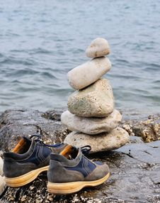 Stones In Balance On The Rocks Of The Sea Stock Photo