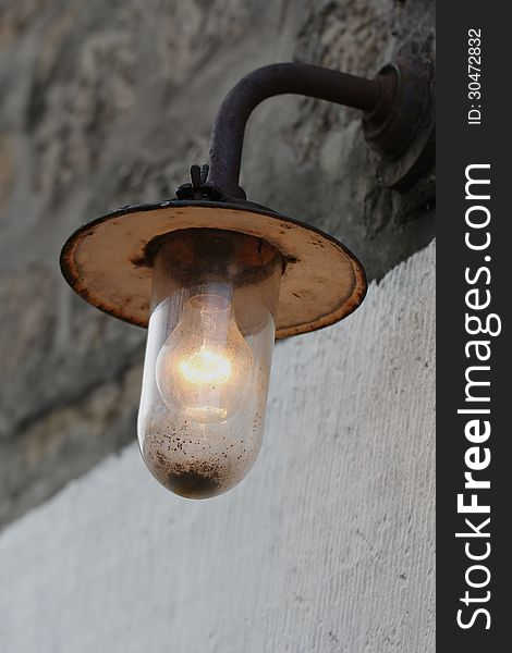 Old vintage dirty rusty bulb lamp