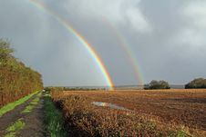 Double Rainbow Over Meadow Stock Photo