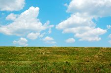 Free Cloudy Sky And Green Grass Stock Image - 3053361