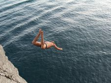 Free Boy Jumping To The Sea Stock Image - 3057301