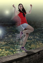 Free Woman In Danger Balancing On One Leg At The Edge Over City Royalty Free Stock Photo - 30502185