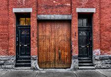 Old  Wooden Doors & Brick Wall Royalty Free Stock Photography