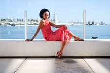 Free Black Woman With Pink Dress And Earrings. Afro Hairstyle Stock Image - 30515671