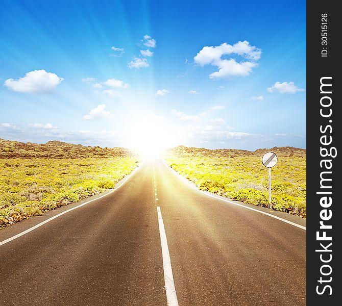 Asphalt road to the sun