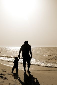 Dad And Child On The Beach At At Sunset Royalty Free Stock Photo
