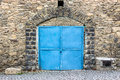 Free Stone Wall With Blue Door Stock Photos - 30557833