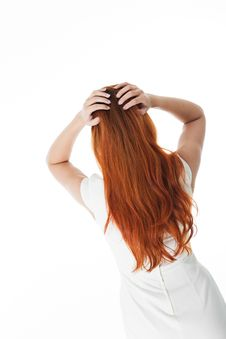 Rear View Of A Woman With Long Red Hair Stock Photos