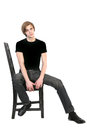 Free Handsome Young Man Sitting On A Chair Royalty Free Stock Images - 30574799