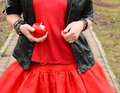 Free A Red Apple In A Hand Of A Girl In A Red Dress Royalty Free Stock Images - 30579149