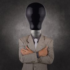 Free Businessman With Black Light Bulb Head Stock Photo - 30571410