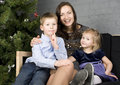 Free Happy Family At Christmas Tree Royalty Free Stock Photo - 30586825