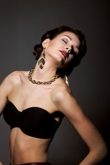 Free Bliss. Sultry Graceful Beauty In Black Bra With Golden Jewelery - Necklace And Earrings Royalty Free Stock Images - 30583249