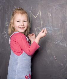 Free Portrait Of Little Cute Girl Near Blackboard Stock Image - 30586871