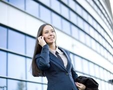 Free Portrait Of Pretty Young Business Woman Talking On Phone Near Building Stock Photography - 30586962