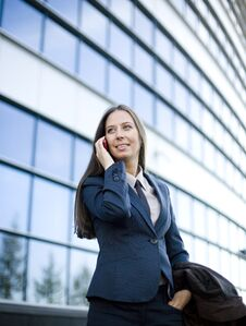 Free Portrait Of Pretty Young Business Woman Talking On Phone Near Building Royalty Free Stock Photo - 30586965