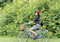 Free Happy Smiling Girl Riding A Bicycle In The Park Royalty Free Stock Photography - 30591657