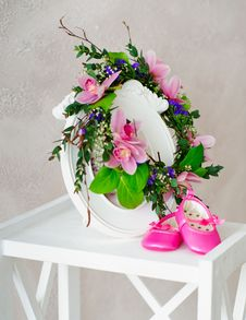 Pink Orchid Wreath And Kid S Shoes Stock Photography