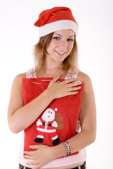 Girl With Christmas Bag Royalty Free Stock Photo