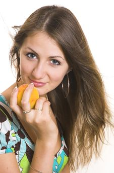 The Young Girl With A Peach Royalty Free Stock Images