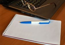 Free Pen With Notebook And Glasses Near Laptop Royalty Free Stock Photography - 30602047