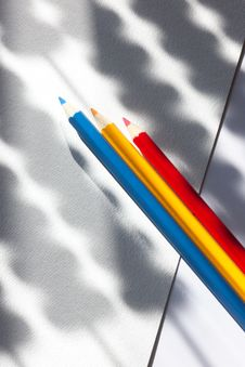 Colored Pencils On Colored Paper With Stripes Stock Images