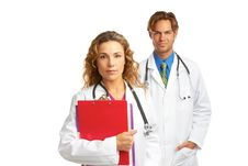 Young Serious Doctor And Nurse Royalty Free Stock Photography