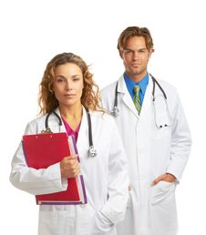 Young Serious Doctor And Nurse Stock Photo