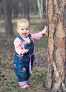 Free Happy Baby Girl  Stands On Legs Near A Tree In The Park Outdoors Stock Photo - 30631450