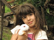 Little Girl And Rabbit Royalty Free Stock Photos