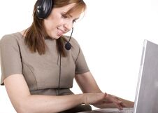 Free Portrait Of Pretty Call Operator Smiling And Typing On Lap Top Stock Image - 30658861
