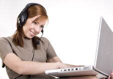Free Portrait Of Pretty Call Operator Smiling And Typing On Lap Top Stock Images - 30658884
