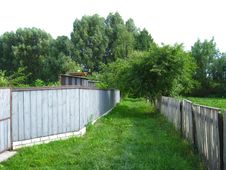 Free Fence And Little Street In Rural Manor Stock Image - 30659821
