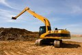 Free Orange Excavator At Construction Site Stock Image - 30679411