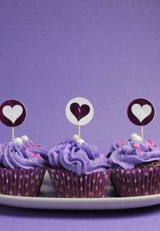 Free Mauve Purple Decorated Cupcakes - Vertical. Royalty Free Stock Photo - 30672875