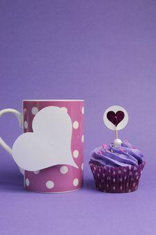 Free Mauve Purple Decorated Cupcake With Pink Polka Dot Coffee Mug - Vertical. Royalty Free Stock Photos - 30672978