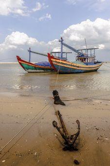 Fishing Boats And  Anchor At Shore-line Stock Photos